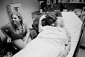Chicago, Illinois<br /> USA<br /> December 17, 2009<br /> <br /> At the University of Chicago Medical Center Geraldine Martin, 80 years old, is prepared for open heart surgery to have a valve replaced and hole repaired. She is accompanied by her sister Helen Martin  who gives her sister a loving kiss before the surgery begins.