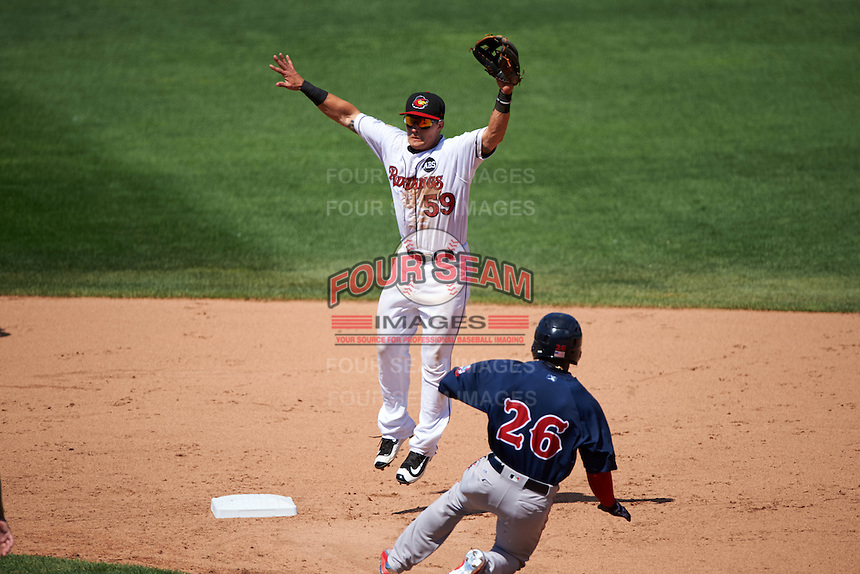 Rochester Red Wings second baseman Tommy Field (59) jumps for a throw as Rusney Castillo (26) slides into second during a game against the Pawtucket Red Sox on June 29, 2016 at Frontier Field in Rochester, New York.  Pawtucket defeated Rochester 3-2.  (Mike Janes/Four Seam Images)
