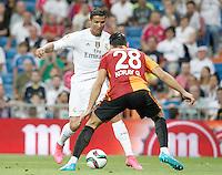 Real Madrid's Cristiano Ronaldo (l) and Galatasaray's Koray Gunter during XXXVI Santiago Bernabeu Trophy. August 18,2015. (ALTERPHOTOS/Acero)