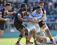 Mako Vunipola of Saracens is tackled by Nathan Hughes and Simon McIntyre of London Wasps during the Aviva Premiership match between London Wasps and Saracens at Adams Park on Saturday 29th March 2014 (Photo by Rob Munro)
