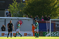 Cork City fans watch the game from the wall.<br /> <br /> Cobh Ramblers v Cork City, SSE Airtricity League Division 1, 28/5/21, St. Colman's Park, Cobh.<br /> <br /> Copyright Steve Alfred 2021.