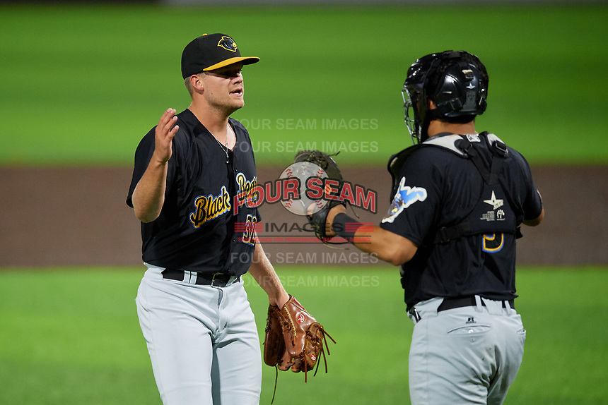 West Virginia Black Bears pitcher Cameron Junker (32) and catcher Elys Escobar (3) celebrate after closing out a NY-Penn League game against the Auburn Doubledays on August 23, 2019 at Falcon Park in Auburn, New York.  West Virginia defeated Auburn 6-5, the second game of a doubleheader.  (Mike Janes/Four Seam Images)