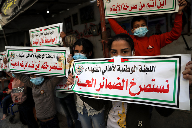 Families of Palestinians who killed during the 2014 Israeli-Palestinian conflict calling Palestinian Authority to reinstate their salaries which was cutting since seven years, in Gaza city, on May 2, 2021. Photo by Mohammed Salem