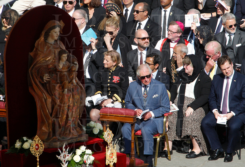 Britain's Prince Charles, center, attend a Mass celebrated by the Pope for the canonization of the blessed Giovanni Enrico Newman, Giuseppina Vannini, Maria Teresa Chiramel Mankidiyan, Dulce Lopes Pontes and Margarita Bays, in St. Peter's Square at the Vatican, October 19, 2019. UPDATE IMAGES PRESS/Riccardo De Luca <br /> <br /> STRICTLY ONLY FOR EDITORIAL USE