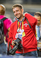 13 October 2016: Washington Nationals Team Photographer Patrick McDermott smiles adjacent the dugout prior to the NLDS Game 5 between the Nationals and the Los Angeles Dodgers at Nationals Park in Washington, DC. The Dodgers edged out the Nationals 4-3, to take Game 5 of the Series, 3 games to 2, and move on to the National League Championship Series against the Chicago Cubs. Mandatory Credit: Ed Wolfstein Photo *** RAW (NEF) Image File Available ***