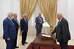 Judge Farid Akl sworn in as a judge in the Constitutional Court in front of Palestinian President Mahmoud Abbas, in the West Bank city of Ramallah on June 12, 2021. Photo by Thaer Ganaim