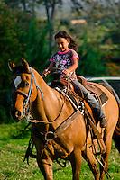 Young girl on horseback, Haiku, Maui