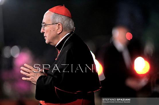 Cardinal Agostino Vallini;Pope Benedict XVI holds the wooden cross during the Via Crucis (Way of the Cross) torchlight procession on Good Friday in front of the Colosseum in Rome, Friday, April 22, 2011.The evening Via Crucis procession at the ancient Colosseum amphitheater is a Rome tradition that draws a large crowd of faithful, including many of the pilgrims who flock to the Italian capital for Holy Week ceremonies before Easter SundayVia Crucis;
