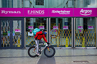 Pictured: A deliveroo worker cycles past a closed Queens Arcade in Cardiff, Wales, UK. Friday 8th January 2021<br /> Re: The whole of Wales in in Tier 4 due to rising Covid-19 Coronavirus cases, Cardiff, Wales, UK.