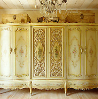 A rococo-style wardrobe is the unusual focal point in this bedroom