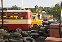 Chatham bay, andaman islands, India. The local deposit for the major kind of road transportations around the island. Trucks, buses and lorries with many discarded tyres
