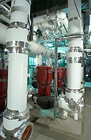 November15,  2001, Montreal, Quebec, Canada<br /> <br /> Industrial photo<br /> <br /> New pumps (in red) in thenew  mecanic room of<br />  the Montreal Convention Centre, are used <br /> to circulate hot water to the new section, currently beeing built (Nov 2001) .<br /> <br /> Mandatory Photo Credit ; Copyright 2001 by Pierre Roussel-Images Distribution <br /> <br /> NOTE : scan from 8x10 print of 2 1/4 negative.<br /> Nikon D-1 digital photos also available.