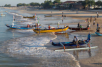 Jimbaran, Bali, Indonesia.  Fishermen Preparing to put their Boats out to Sea in the Early Morning.