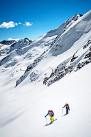 The Ortler Group in northern Italy is a popular region for spring ski touring using the huts for overnights to ski all the many peaks in the mountain group. Ski tourers climbing the Punta Pedranzini, 3599 meters.
