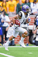 TCU wide receiver Cameron Echols-Luper (15) attempts to return a kick during an NCAA football game, Saturday, October 11, 2014 in Waco, Tex. Baylor defeated TCU 61-58 to remain undefeated in BIG 12 conference. (Mo Khursheed/TFV Media via AP Images)