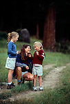 A mother and her daughters stop to talk along a trail in Rocky Mtn Nat'l Park, CO