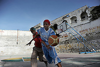Death or Play. Women´s Basketball in Mogadishu.Women's basketball? In Europa and the U.S., we take it for granted. But consider this: In Mogadishu, war-torn capital of Somalia, young women risk their lives every time they show up to play..Suweys, the captain of the Somali women´s basketball team, and her friends play the sport of the deadly enemy, called America. This is why they are on the hit list of the killer commandos of Al Shabaab, a militant islamist group, that has recently formed an alliance with the terrorist group Al Qaeda and control large swathes of Somalia...Al Shabaab, who sets bombs under market stands, blows up cinemas, and stones women, has declared the female basketball players ?un-islamic?. One of the proposed punishments is to saw off their right hands and left feet. Or simply: shoot them...Suweys´ team trains behind bullet-ridden walls, in the ruins of the failed city of Mogadishu - protected by heavily armed gun-men. The women live in constant fear of the islamist killer commandos. Stop playing basketball? Never, they say..Women´s basketball in the world´s most dangerous capital..