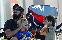 Jul. 18, 2009; Augusta, GA, USA; IHBA fans cover their ears as a boat warms up during qualifying for the Augusta Southern Nationals on the Savannah River. Mandatory Credit: Mark J. Rebilas-