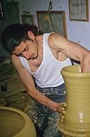 Ceramics, Nabeul, Tunisia.  Potter at Work, Shaping a Pot.