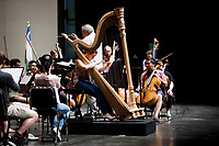 Melanie Laurent from France performs during an orchestra rehearsal for the Final Stage concert at the 11th USA International Harp Competition at Indiana University in Bloomington, Indiana on Friday, July 12, 2019. (Photo by James Brosher)