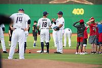Northwest Arkansas Naturals infielders Gabriel Cancel (18) (center) and Samir Duenez (13) take the field on May 6, 2019, at Arvest Ballpark in Springdale, Arkansas. (Jason Ivester/Four Seam Images)