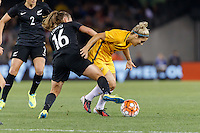 June 7, 2016: ANNALIE LONGO (16) of New Zealand and KATRINA GORRY (19) of Australia fight for the ball during an international friendly match between the Australian Matildas and the New Zealand Football Ferns as part of the teams' preparation for the Rio Olympic Games at Etihad Stadium, Melbourne. Photo Sydney Low
