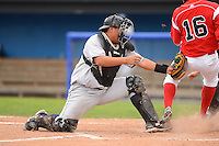 Jamestown Jammers catcher Jin-De Jhang #47 tags Connor Burke #16 too late while scoring a run during a game against the Batavia Muckdogs on June 27, 2013 at Dwyer Stadium in Batavia, New York.  The game was postponed in the 4th inning due to rain.  (Mike Janes/Four Seam Images)