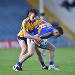 John Murphy of  Clare  in action against Christy English of  Tipperary during their Munster Minor football semi-final at Thurles. Photograph by John Kelly.