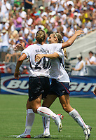 Abby Wambach celebrates her PK with Heather Mitts. The USA defeated Canada 2-0 at SAS Stadium in Cary, NC on Sunday, July 30, 2006.