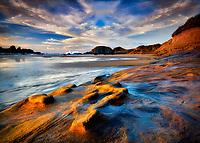 sandstone rock structure on shore of Seal Rock, Oregon