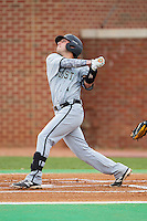 Michael Paez (1) of the Coastal Carolina Chanticleers follows through on his swing against the High Point Panthers at Willard Stadium on March 14, 2014 in High Point, North Carolina.  The Panthers defeated the Chanticleers 3-0.  (Brian Westerholt/Four Seam Images)