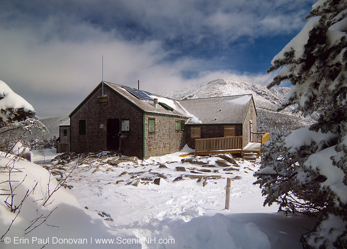 Greenleaf Hut with Mount Lafayette in the background in the White Mountain National Forest of New Hampshire. The Appalachian Trail travels across the summit of Mount Lafayette.