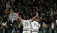 Calcio, Serie A: Juventus vs Milan. Torino, Juventus Stadium, 21 novembre 2015. <br /> Juventus' Paulo Dybala, left, celebrates past his teammate Leonardo Bonucci after scoring the winning goal during the Italian Serie A football match between Juventus and AC Milan at Turin's Juventus stadium, 21 November 2015. Juventus won 1-0.<br /> UPDATE IMAGES PRESS/Isabella Bonotto