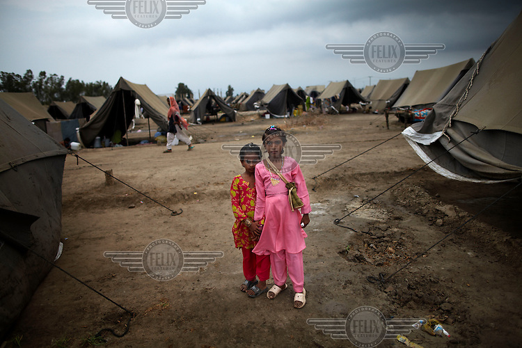Young sisters dress up to celebrate Eid at an IDP (internally displaced persons) camp set up by UNHCR (United Nations High Commission for Refugees) for those affected by the flooding. Severe flooding had left at least 1,600 people dead and affected up to 20 million.