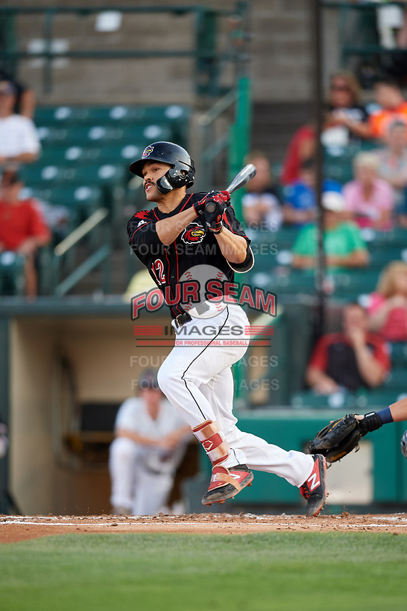 Rochester Red Wings first baseman Zander Wiel (12) hits a single during a game against the Lehigh Valley IronPigs on September 1, 2018 at Frontier Field in Rochester, New York.  Lehigh Valley defeated Rochester 2-1.  (Mike Janes/Four Seam Images)