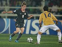 Alex Shinsky (8) controls the ball afains Jordi Amat (14). Spain defeated the U.S. Under-17 Men National Team  2-1 at Sani Abacha Stadium in Kano, Nigeria on October 26, 2009.