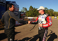 Mar. 13, 2011; Gainesville, FL, USA; NHRA funny car driver Cruz Pedregon (left) congratulates Mike Neff for winning the Gatornationals at Gainesville Raceway. Mandatory Credit: Mark J. Rebilas-.