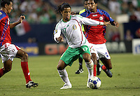 Mexico's Giovani Dos Santos (17) maneuvers through the Costa Rican defense.  Mexico defeated Costa Rica 2-1 on penalty kicks in the semifinals of the Gold Cup at Soldier Field in Chicago, IL on July 23, 2009.