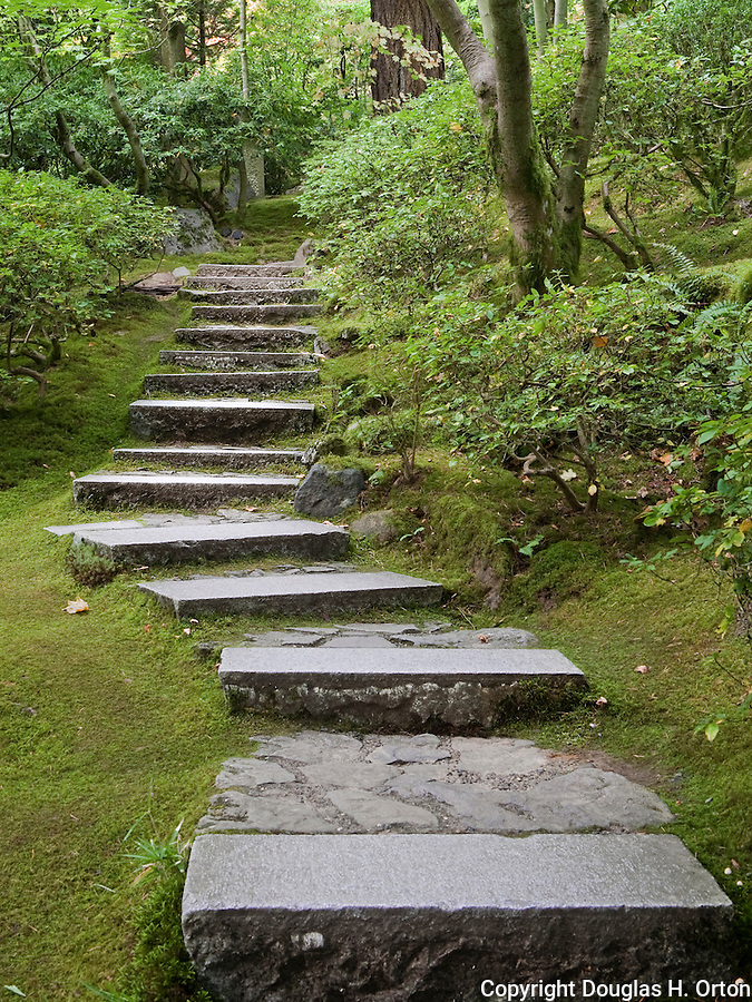 Stone stairway winds through garden.  The Japanese Garden in Portland is a 5.5 acre respit.  Said to be one of the most authentic Japanese Garden's outside of Japan, the rolling terrain and water features symbolize both peace and strength.
