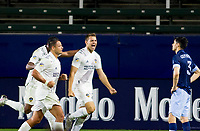 """CARSON, CA - OCTOBER 18: Kai Koreniuk #28 of the Los Angeles Galaxy scores his goal and celebrates with team mates Carlos Harvey #67 and Javier """"Chicharito"""" Hernandez #14 during a game between Vancouver Whitecaps and Los Angeles Galaxy at Dignity Heath Sports Park on October 18, 2020 in Carson, California."""