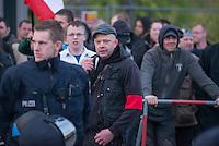 """Ca. 50 Neonazis der NPD, der Neonazi-Partei """"Die Rechte"""" und Hooligans protestierten am 20. April 2015 in Berlin Marzahn-Hellersdorf gegen eine geplante Fluechtlingsunterkunft. Die Neonazis wollten ein """"Geburtstagsstaendchen"""" anlaesslich des Hitlergeburtstages (20. April) singen, dies wurde ihnen von der Polizei jedoch untersagt.<br /> Im Bild mit Schiebermuetze: Demonstrationsleiter Rene Uttke. Massgebliocher Aktivist gegen die Fluechtlingsunterkunft.<br /> 20.4.2015, Berlin<br /> Copyright: Christian-Ditsch.de<br /> [Inhaltsveraendernde Manipulation des Fotos nur nach ausdruecklicher Genehmigung des Fotografen. Vereinbarungen ueber Abtretung von Persoenlichkeitsrechten/Model Release der abgebildeten Person/Personen liegen nicht vor. NO MODEL RELEASE! Nur fuer Redaktionelle Zwecke. Don't publish without copyright Christian-Ditsch.de, Veroeffentlichung nur mit Fotografennennung, sowie gegen Honorar, MwSt. und Beleg. Konto: I N G - D i B a, IBAN DE58500105175400192269, BIC INGDDEFFXXX, Kontakt: post@christian-ditsch.de<br /> Bei der Bearbeitung der Dateiinformationen darf die Urheberkennzeichnung in den EXIF- und  IPTC-Daten nicht entfernt werden, diese sind in digitalen Medien nach §95c UrhG rechtlich geschuetzt. Der Urhebervermerk wird gemaess §13 UrhG verlangt.]"""
