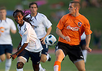 Mustapha Riga of the Bolton Wanderers and Jo Conner of the Charlotte Eagles contest the ball.  The Charlotte Eagles currently in 3rd place in the USL second division played a friendly against the Bolton Wanderers from the English Premier League losing 3-0.
