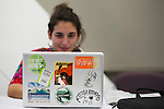 Sara and her laptop at Powershift in Pittsburgh, PA. USA. (Photo by: Robert van Waarden)