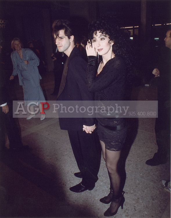 """Dec 08, 1988 - Century City, California, USA - Actress Cher and boyfriend Rob Camilletti arrive for the premiere of """"Torch Song Trilogy"""" at the theater in Century City, Calif., Wednesday night, Dec. 8, 1988. .(Credit Image: © Alan Greth/Alan Greth)"""