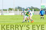 Lixnaw's Chris O'Sullivan been pinned in by Niall Cassidy and Luke Benson of Tralee Parnells in the U16 Hurling plate final.