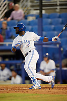 Dunedin Blue Jays center fielder Anthony Alford (43) follows through on a swing during a game against the Fort Myers Miracle on April 17, 2018 at Dunedin Stadium in Dunedin, Florida.  Dunedin defeated Fort Myers 5-2.  (Mike Janes/Four Seam Images)