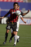 he MetroStars' Gilberto Flores attempts to control the ball while being marked by the Galaxy's Andreas Herzog. The LA Galaxy were defeated by the NY/NJ MetroStars 2 to 1 at Giant's Stadium, East Rutherford, NJ, on June 19, 2004.