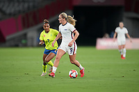 TOKYO, JAPAN - JULY 20: Lindsey Horan #9 of the United States looking for an open man during a game between Sweden and USWNT at Tokyo Stadium on July 20, 2021 in Tokyo, Japan.