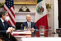 United States participates in a virtual bilateral meeting with President Andrés Manuel López Obrador of Mexico in the Roosevelt Room of the White House in Washington on March 1st, 2021.  At left is US Secretary of State Antony Blinken.<br /> Credit: Anna Moneymaker / Pool via CNP /MediaPunch