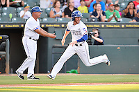 Round Rock Express out fielder Ryan Strausborger (6) scores during pacific coast league baseball game, Friday August 15, 2014 in Round Rock, Tex. Reno defeats Round Rock 11-9 to sweep three game series. (Mo Khursheed/TFV Media via AP Images)